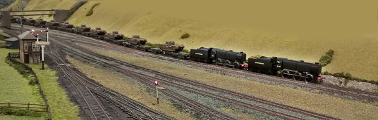 Engines C21 anad C24 on train carrying tanks at Chinley